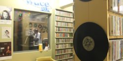 View of college radio station WDCE's on-air studio from the college radio station's CD library. Photo: J. Waits