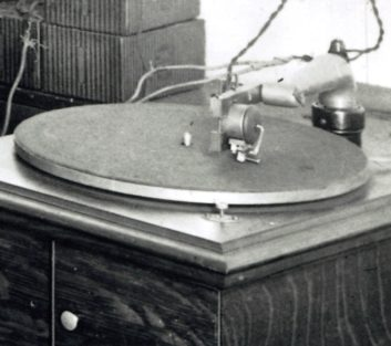 """close-up of phonograph arm and """"pickup"""" in KDKA radio room"""