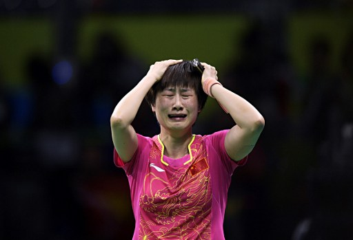 China's Ding Ning celebrates beating China's Li Xiaoxia in their women's singles gold medal table tennis match at the Riocentro venue during the Rio 2016 Olympic Games in Rio de Janeiro on August 10, 2016. / AFP PHOTO / Juan Mabromata