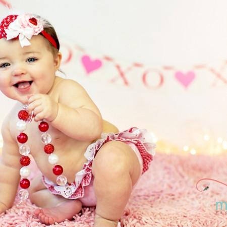 Darling Valentine's Day baby picture idea with cute raegunshop.com ruffle diaper coves