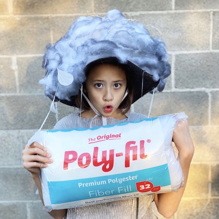 girl in cloud hat holding poly-fil bag