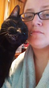 Here, have a picture of me and a cat for an apology <3