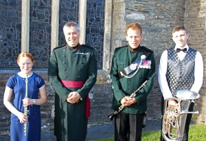 All smiles from 12 year old Maia Roberts from Helston, Major Peter Clark - Musical Director, WO2 Bob Ghigi - Bandmaster and 17 year Gregory Graves from Callington. Maia and Gregory were given the unique opportunity of taking part in a concert given by The Waterloo Band and Bugles of the Rifles. Picture by Chris Cox BOCC20150525A-002_C