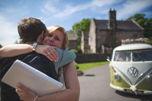 emotional sister of bride hugging groom