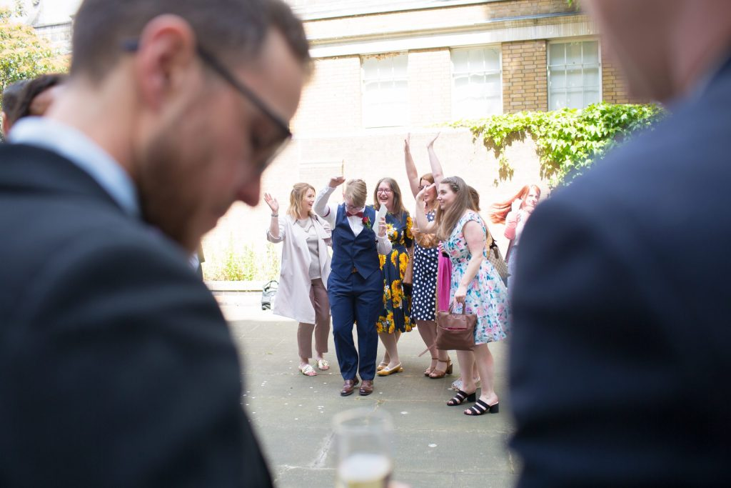 bride dancing with friends