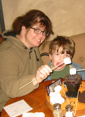 Ann and Jack roasting marshmallows