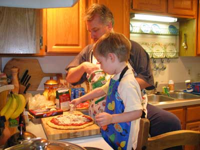 Dad and Jack making pizza