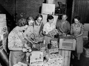 Red cross workers packing aid parcels