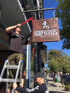 Installing the sign for our new retail store