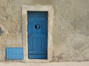 Blue Door Set In Grey Wall
