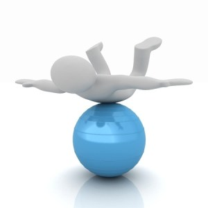 a cartoon figure balancing on his belly on top of a blue ball indicating balancing is the key
