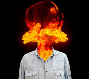 image of man with head replaced by fire simulating extreme emotional reaction of anger