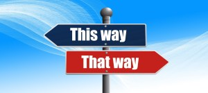 Two signs on the same post - one blue pointing in one direction and says This Way - the other pointing in the other direction and saying That way - which way is the right way to go?
