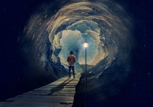 image of a man standing at the opening of a tunnel looking out into open space with a lit lamp in the center of his view