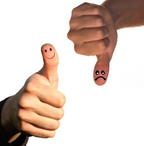 image of two thumbs, one pointing up with a smile and one pointng down with a frown to indicate opposite viewpoints