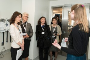 Ragon Fellow Shannon Wilton gives visitors a tour of the facilities