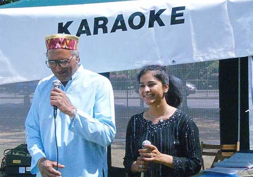Rahi Bains with a friend at the Karaoke Stall at The Southampton Mela