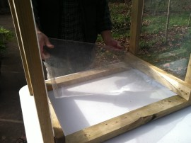 Placing the plexiglass sides in the coldframe.