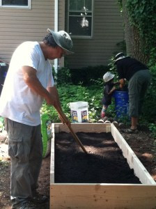 Filling the raised beds with a mixture of garden soil and compost. (Summer 2012)