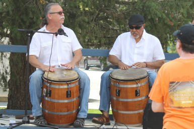 Two drummers playing bariles de bomba.