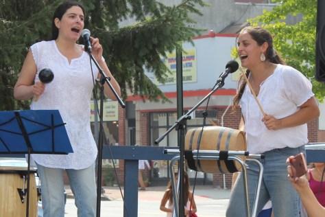 Isabel Ruano and Nicole Wines sining bomba.