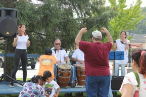 Farmer's Market Festival manager and Raíces Cultural Center supporter Paul Alirangues dancing before the drum, along with other festival participants.