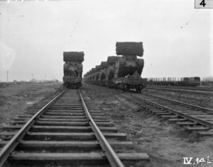 Trains loaded with tanks at Plateau, November 1917