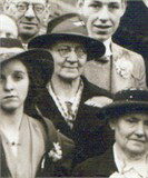Rose Reid, pictured in later life, wearing glasses & a hat.
