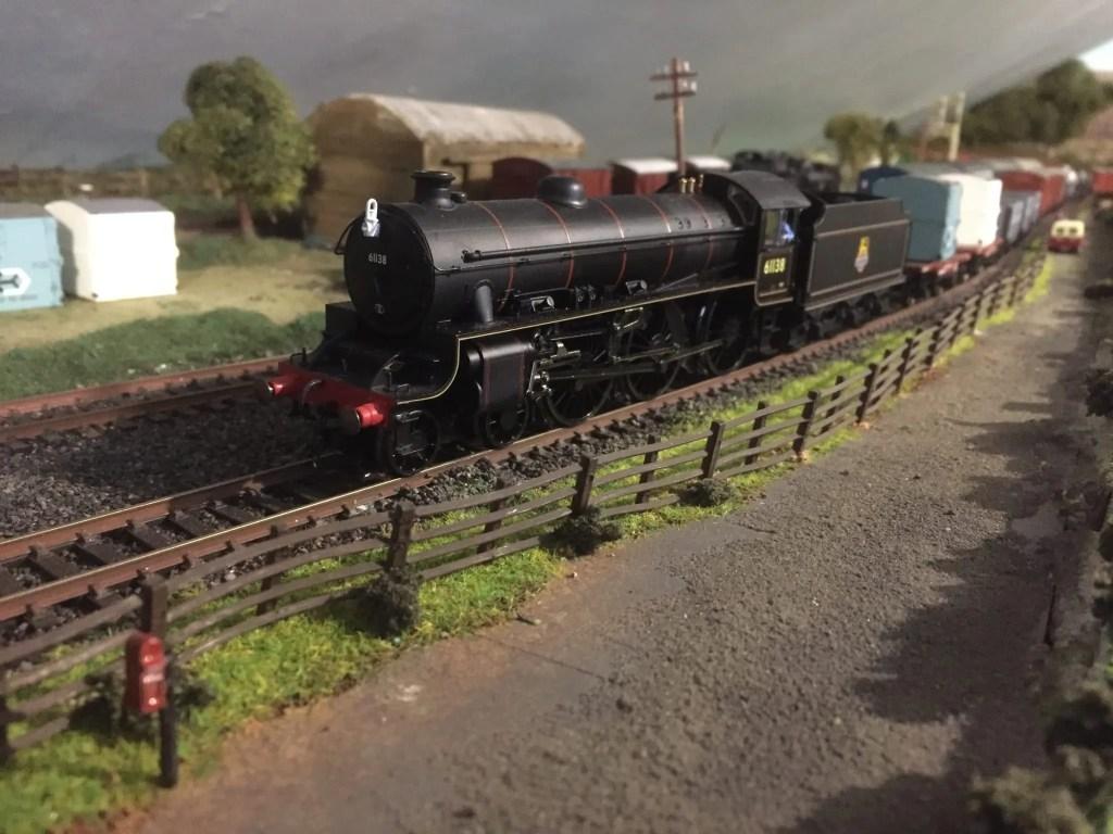 00 gauge model railway layout with steam locomotive