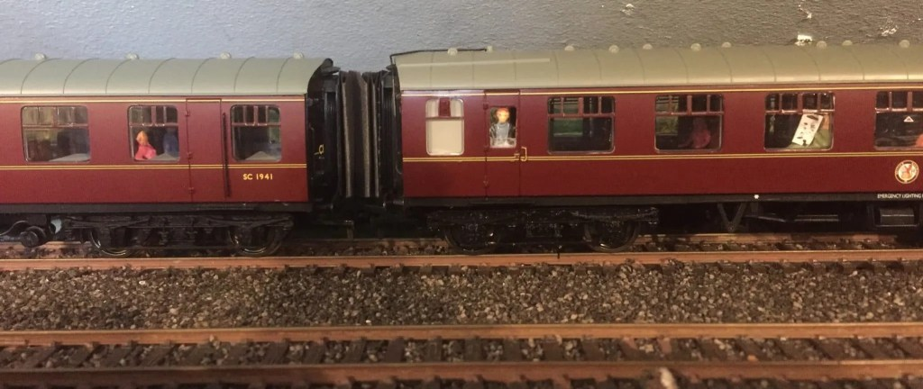 realistic model railway carriage with people