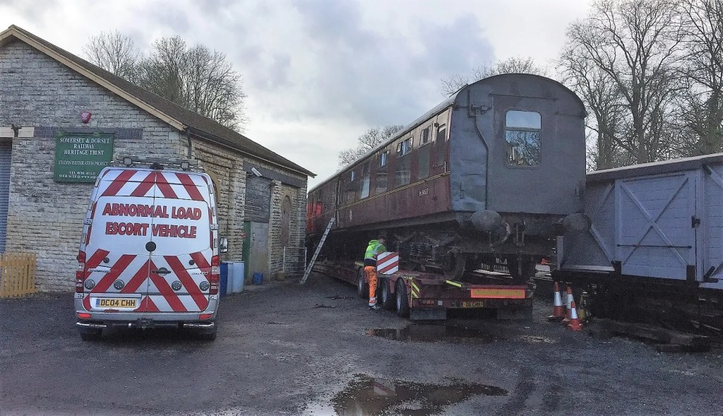 British Railways Mark 1 carriage on the back of a low loader at the Somerset and Dorset Joint Railway