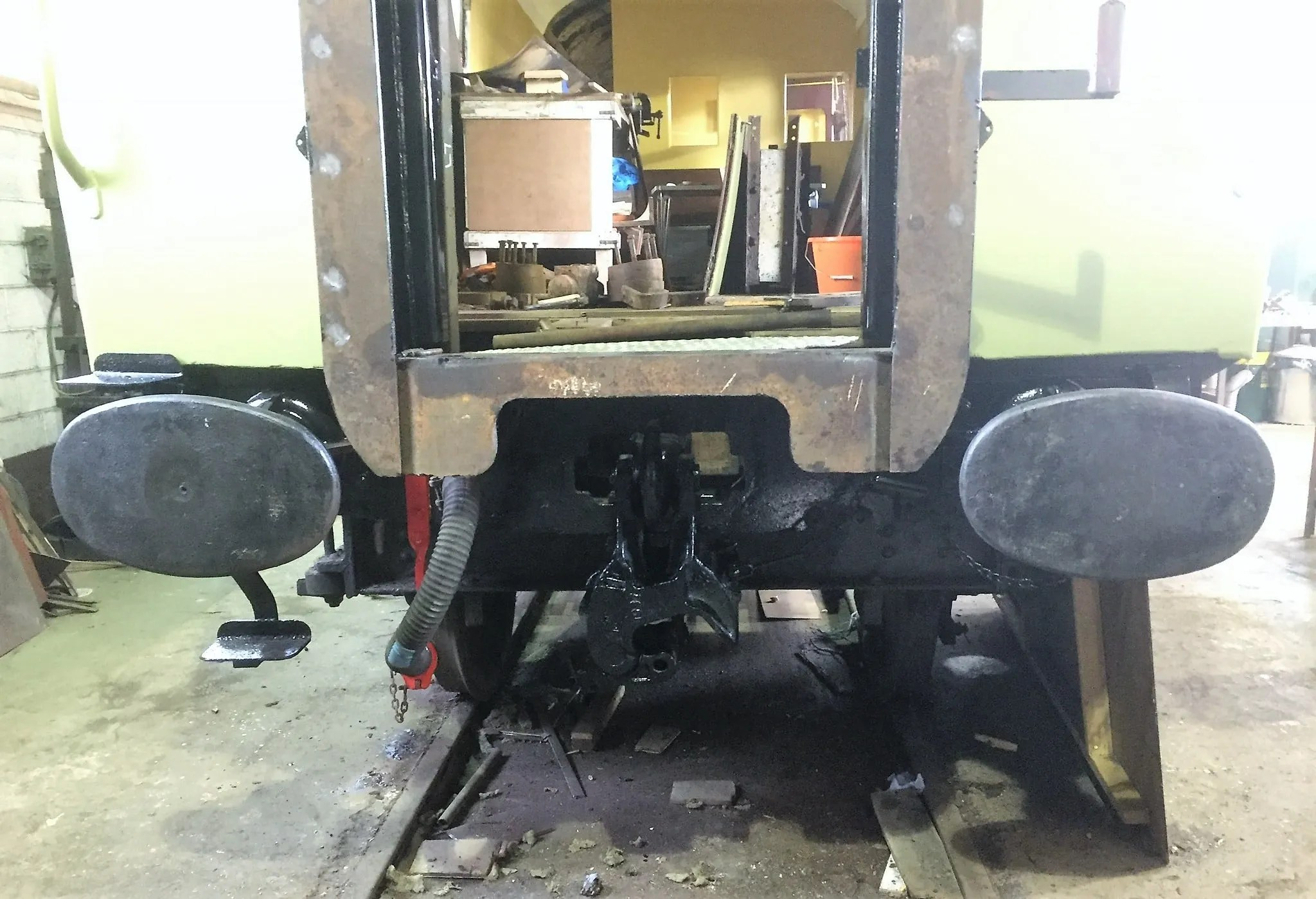 Newly fitted gangway being supported on plungers and newly painted Buckeye coupler as part of Mark 1 carriage restoration