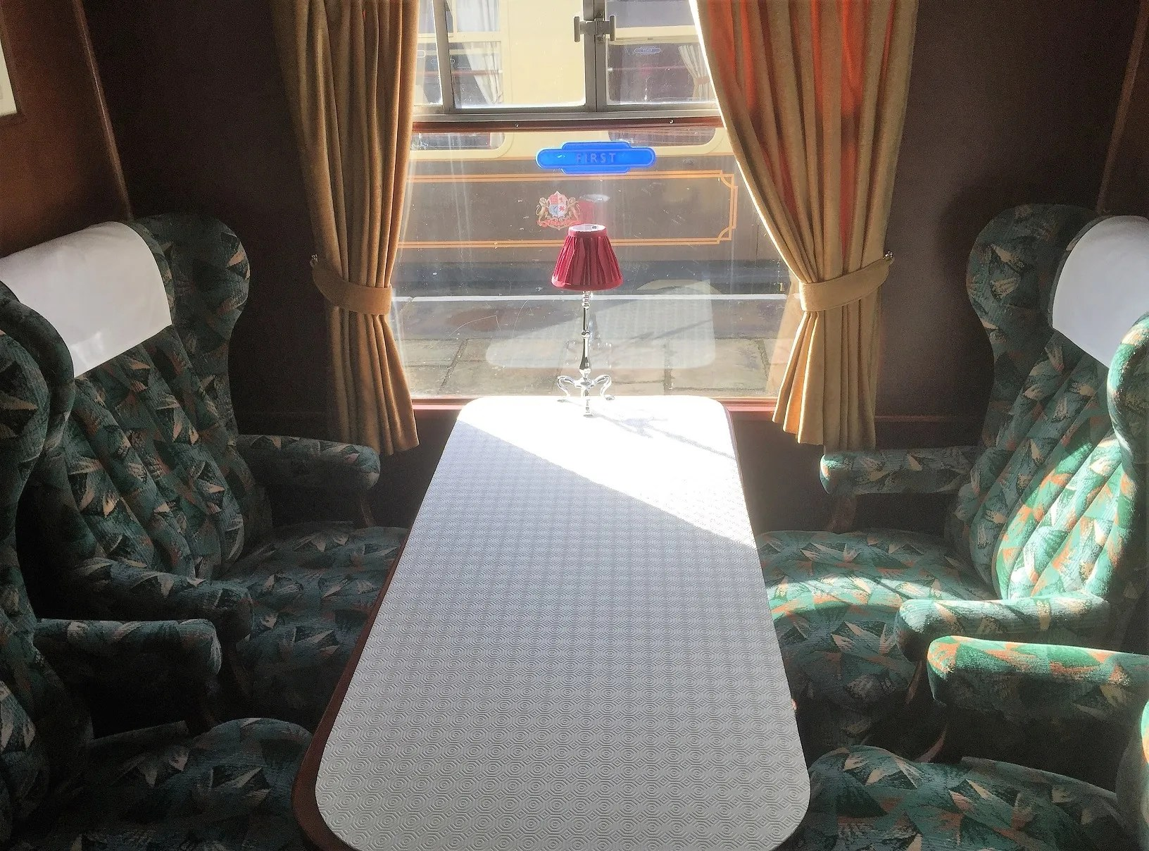railway carriage restaurant CK M15626 Oliver showing loose chairs that have replaced the bench seating
