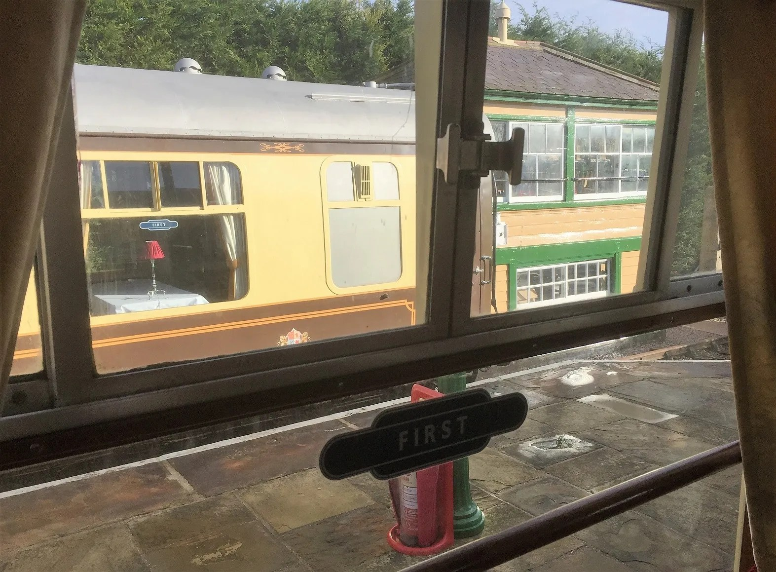 view of signal box from railway carriage restaurant
