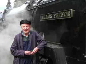 David Shepherd with steam locomotive Black Prince