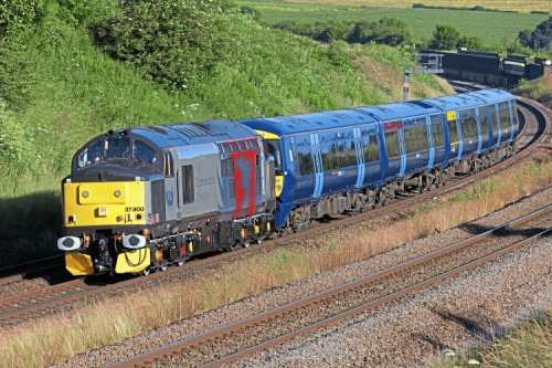 On July 2, ex-works Class 37 No. 37800 is seen just to the south of Wellingborough with the 5Q58 04.40 Derby Litchurch Lane-Ramsgate unit move, hauling Southeastern 'Electrostar' No. 375706. RICHARD GENNIS