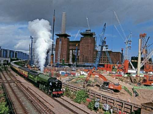 New build meets re-build: No. 60163 Tornado drifts past the Battersea Power Station development on September 30, while in charge of the British Pullman. JAMES HAMILTON