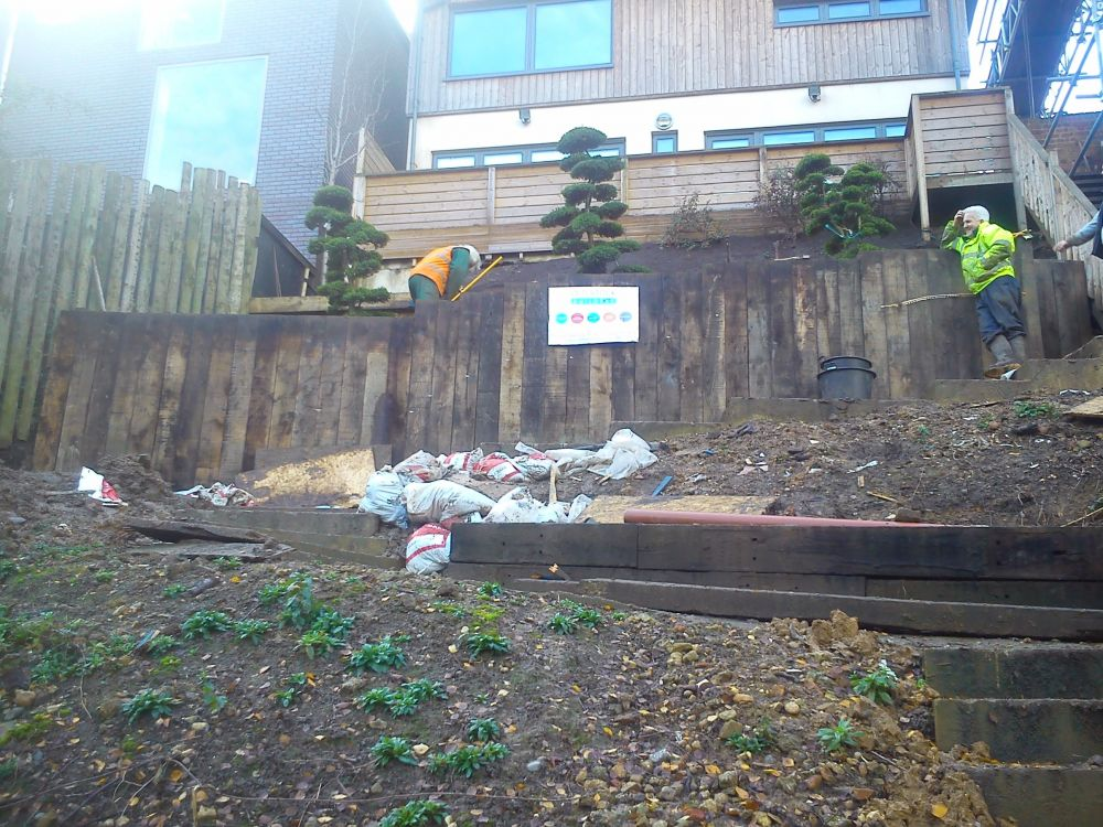 Retaining Wall On Steep Slope With New Oak Railway Sleepers