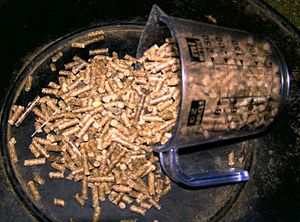 a manufactured pelleted ration for horses, mad...