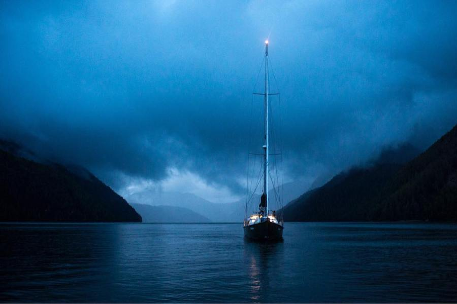 Achiever sits at rest on a clam quiet night in the Great Bear Rainforest.