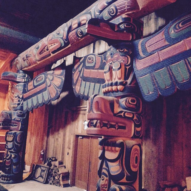 stunning red and purple hues on Coastal First Nations carvings that make up the Big House in Klemtu