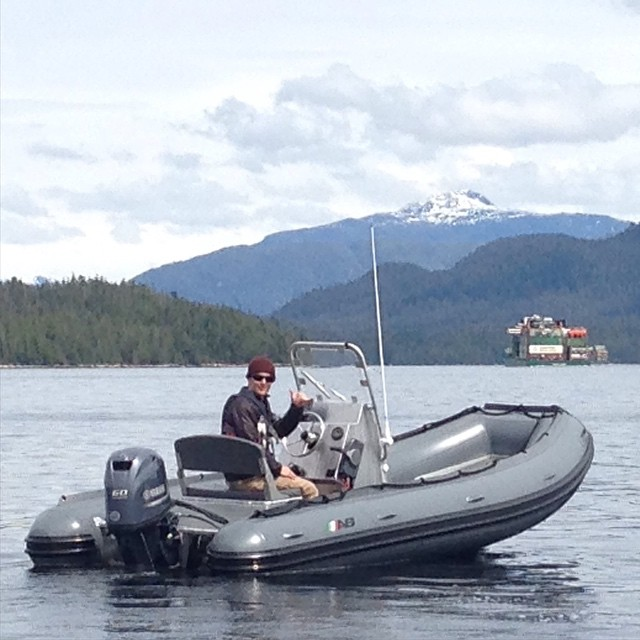 Raincoast staff on new motor boat Fido
