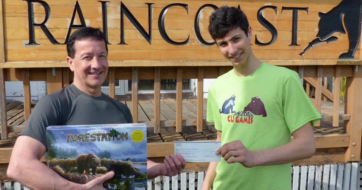 Joseph Weinerman gives Chris Genovali a cheque from proceeds of the Forestation game.