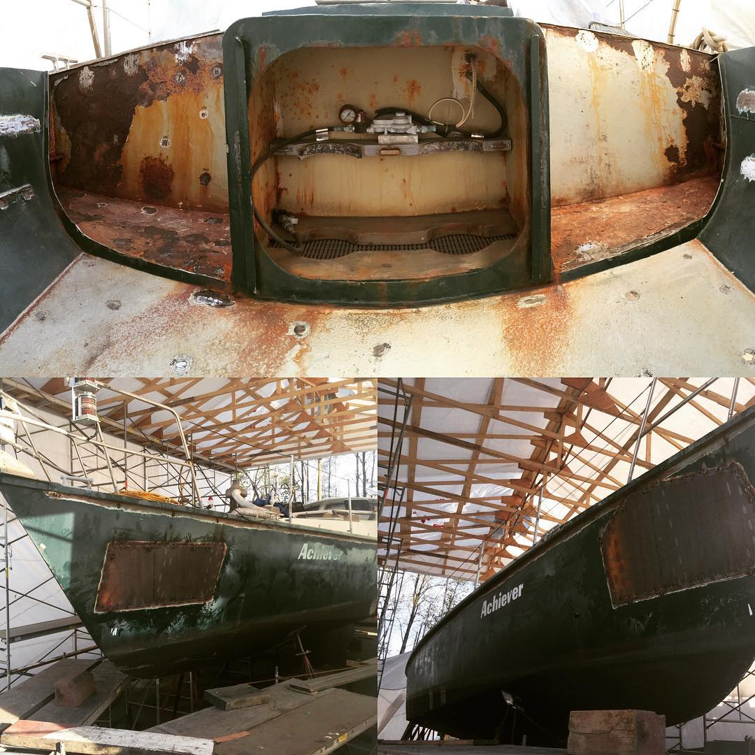 Inside the white and rusty bow of a sailboat mid-repairs.
