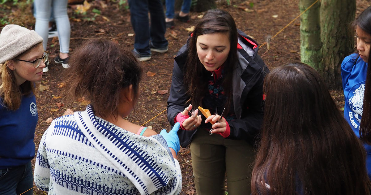 Lauren Henson, PhD student in the Raincoast ACS Lab, demonstrating hair collection techniques for keen students.