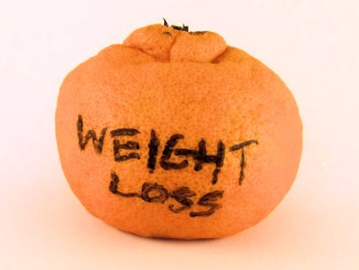 Weight loss written on fruit