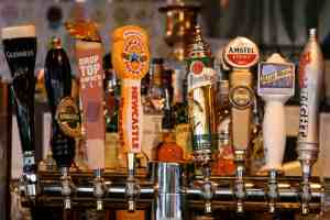 A collection of beer tap handles