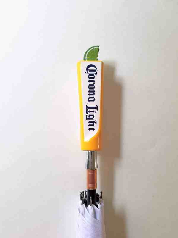 Corona Brewery umbrella made with a small Corona Light tap with lime