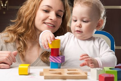 Creating towers help baby's math skils