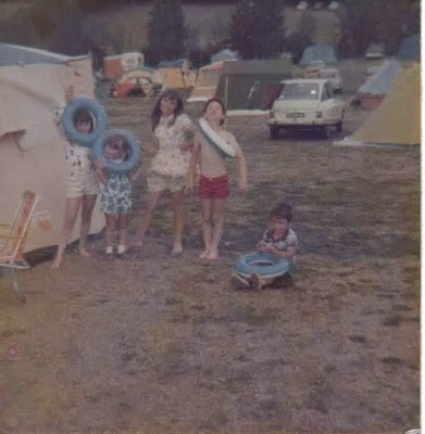 Myself, and four other young children on a camping holiday in the 70s. Each of us posing with an inflatable ring.